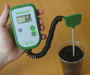 Using a pH meter to test garden soil