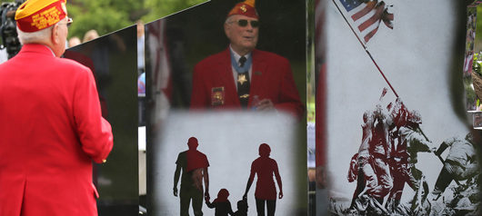 Herschel Woody Williams salutes a Gold Star Monument