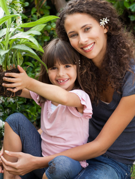 A mother and daughter enjoy the health benefits of gardening